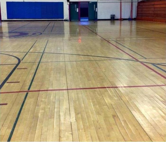 Gymnasium Hardwood Floor and Expert SERVPRO Water Removal After
